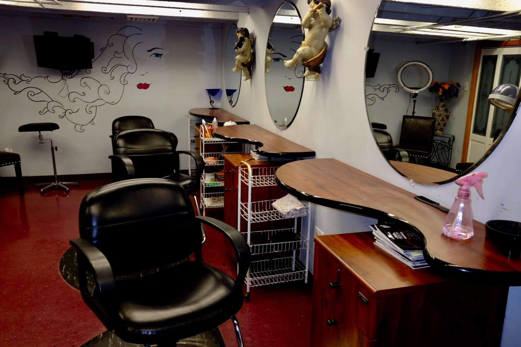 hair stylist stations with chairs and mirrors inside south philly salon